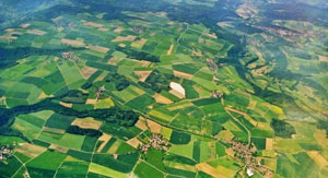 Aerial view of a landscape with meadows and fields